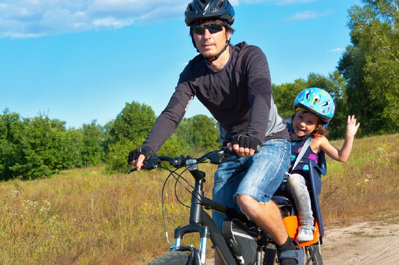Child on a rear mounted bike seat