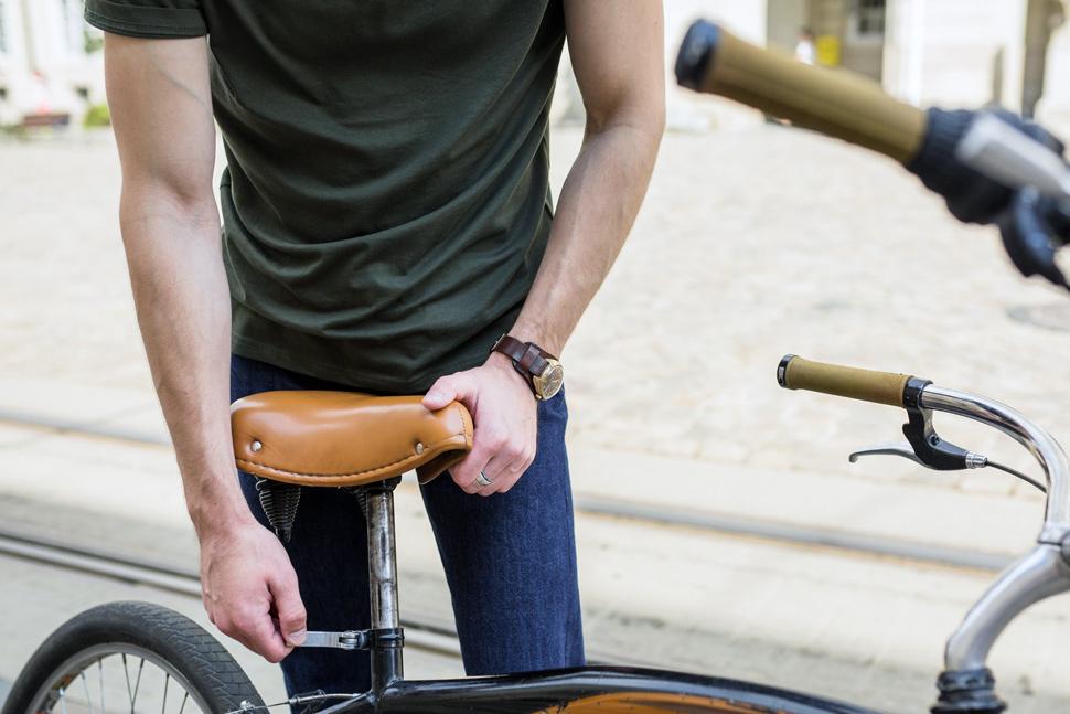 Man adjusting bicycle