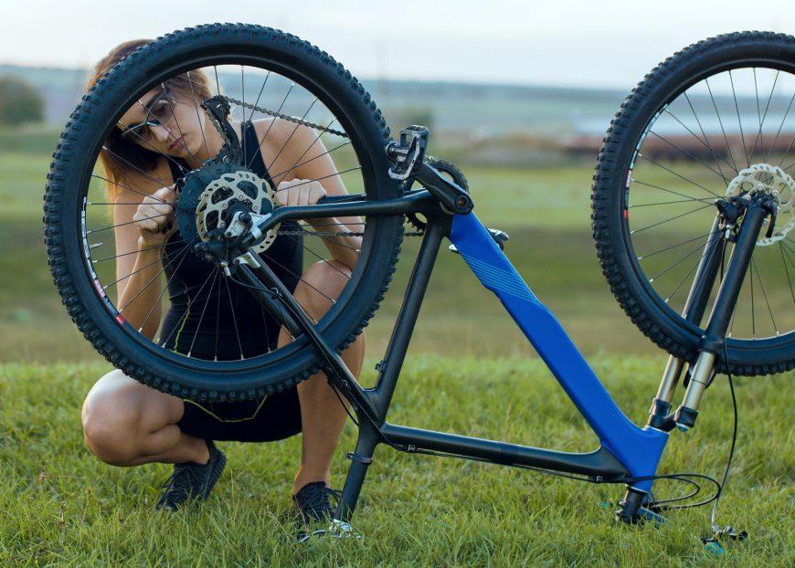 Girl Repairing Mountain Bike